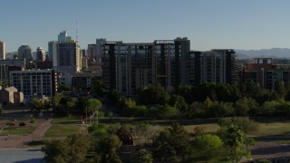 DX0002_138_024 - 5.7K stock footage aerial video of orbiting a condominium complex in Downtown Phoenix, Arizona