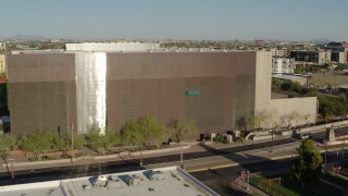 DX0002_138_025 - 5.7K stock footage aerial video of orbiting a public library building in Phoenix, Arizona