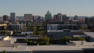 DX0002_138_032 - 5.7K stock footage aerial video of high-rise office buildings in the distance in Downtown Phoenix, Arizona
