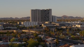 DX0002_138_056 - 5.7K stock footage aerial video of orbiting a hospital complex at sunset in Phoenix, Arizona