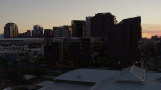 DX0002_139_002 - 5.7K stock footage aerial video of flying by college buildings at sunset in Downtown Phoenix, Arizona