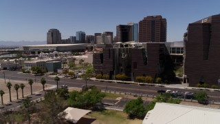 DX0002_140_006 - 5.7K stock footage aerial video flyby city's skyline to reveal college buildings in Downtown Phoenix, Arizona