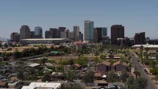 DX0002_140_010 - 5.7K stock footage aerial video of flying by the city's skyline, seen from homes in Downtown Phoenix, Arizona