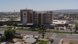 DX0002_140_020 - 5.7K stock footage aerial video of orbiting a hospital complex in Phoenix, Arizona