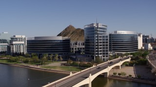 DX0002_142_002 - 5.7K stock footage aerial video of a reverse view of modern office buildings in Tempe, Arizona