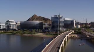 DX0002_142_003 - 5.7K stock footage aerial video of orbiting modern office buildings in Tempe, Arizona