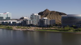 DX0002_142_004 - 5.7K stock footage aerial video of approaching a riverfront condominium complex in Tempe, Arizona