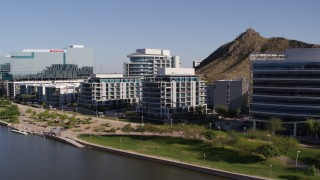 DX0002_142_005 - 5.7K stock footage aerial video of a reverse view of a riverfront condominium complex in Tempe, Arizona