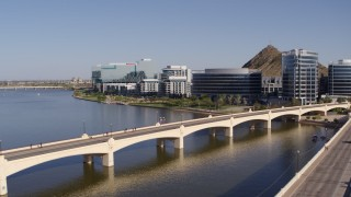 DX0002_142_006 - 5.7K stock footage aerial video fly away from riverfront condominium complex and office buildings in Tempe, Arizona