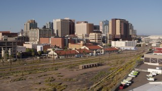 DX0002_142_020 - 5.7K stock footage aerial video of flying away from the city's skyline and train station in Downtown Phoenix, Arizona