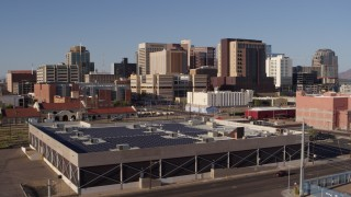 DX0002_142_023 - 5.7K stock footage aerial video of the city's skyline seen while flying past train station in Downtown Phoenix, Arizona