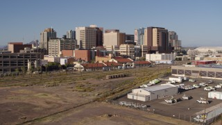 DX0002_142_025 - 5.7K stock footage aerial video of train station and skyline in Downtown Phoenix, Arizona