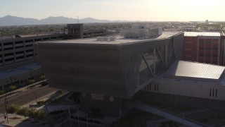 DX0002_142_030 - 5.7K stock footage aerial video of circling the Maricopa County Sheriff's Office at sunset in Downtown Phoenix, Arizona