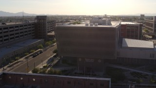 DX0002_142_031 - 5.7K stock footage aerial video orbit the side of the Maricopa County Sheriff's Office at sunset in Downtown Phoenix, Arizona