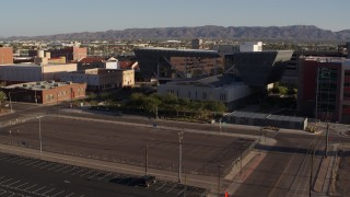 DX0002_142_032 - 5.7K stock footage aerial video fly away from the Maricopa County Sheriff's Office at sunset in Downtown Phoenix, Arizona