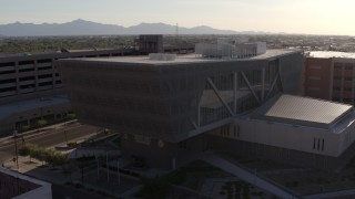 DX0002_142_034 - 5.7K stock footage aerial video of an orbit of the Maricopa County Sheriff's Office building at sunset in Downtown Phoenix, Arizona
