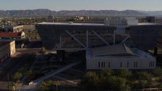 DX0002_142_037 - 5.7K stock footage aerial video orbit parking garage and reveal Maricopa County Sheriff's Office at sunset, Downtown Phoenix, Arizona