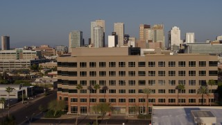 DX0002_143_003 - 5.7K stock footage aerial video the city's skyline while flying by state government offices at sunset in Downtown Phoenix, Arizona