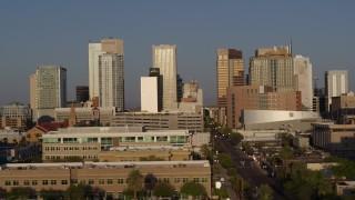 DX0002_143_018 - 5.7K stock footage aerial video focus on city's skyline at sunset, flyby Adams Street, Downtown Phoenix, Arizona