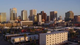 DX0002_143_030 - 5.7K stock footage aerial video of a view of the city's skyline at sunset, Downtown Phoenix, Arizona