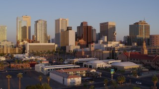 DX0002_143_031 - 5.7K stock footage aerial video of a reverse view of the city's skyline at sunset, Downtown Phoenix, Arizona