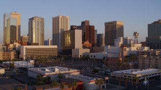 DX0002_143_033 - 5.7K stock footage aerial video of flying past the city's skyline at sunset, Downtown Phoenix, Arizona
