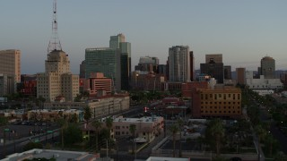 DX0002_143_047 - 5.7K stock footage aerial video of a view of the Westward Ho building and tall office towers at sunset, Downtown Phoenix, Arizona