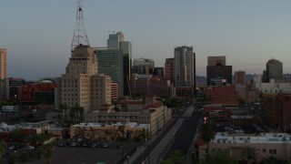DX0002_143_049 - 5.7K stock footage aerial video of towering office buildings seen from 1st Avenue at sunset, Downtown Phoenix, Arizona