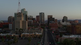 DX0002_143_050 - 5.7K stock footage aerial video of passing towering office buildings seen from 1st Avenue at sunset, Downtown Phoenix, Arizona