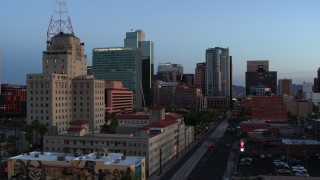 DX0002_143_054 - 5.7K stock footage aerial video of towering office buildings, orbit Westward Ho building at twilight, Downtown Phoenix, Arizona