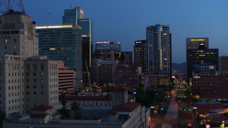 DX0002_143_056 - 5.7K stock footage aerial video of towering office buildings, reveal Westward Ho building at twilight, Downtown Phoenix, Arizona