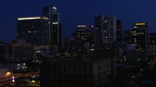 DX0002_143_071 - 5.7K stock footage aerial video slowly passing by high-rise office towers at twilight, Downtown Phoenix, Arizona