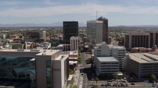 DX0002_144_005 - 5.7K stock footage aerial video of orbiting three high-rise office buildings in Downtown Tucson, Arizona