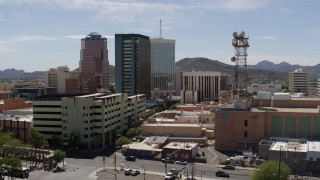 DX0002_144_007 - 5.7K stock footage aerial video of orbiting three office high-rises and reveal Sentinel Peak, Downtown Tucson, Arizona