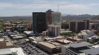 DX0002_144_008 - 5.7K stock footage aerial video of a wide orbit around three tall office high-rises in Downtown Tucson, Arizona