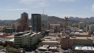 DX0002_144_014 - 5.7K stock footage aerial video descend and orbit high-rise office buildings in Downtown Tucson, Arizona