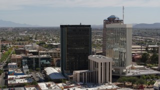 DX0002_144_018 - 5.7K stock footage aerial video of orbiting and flying away from tall office high-rises in Downtown Tucson, Arizona