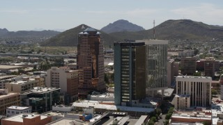 DX0002_144_020 - 5.7K stock footage aerial video orbiting office towers with Sentinel Peak behind them, Downtown Tucson, Arizona