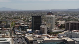 DX0002_144_023 - 5.7K stock footage aerial video of a wide orbit around tall high-rise office towers, Downtown Tucson, Arizona