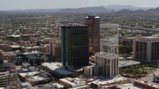 DX0002_144_024 - 5.7K stock footage aerial video of flying by tall high-rise office towers, Downtown Tucson, Arizona