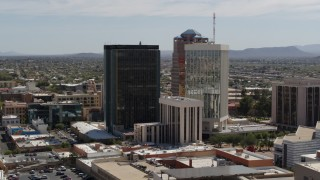 DX0002_144_025 - 5.7K stock footage aerial video of tall high-rise office towers seen during descent, Downtown Tucson, Arizona