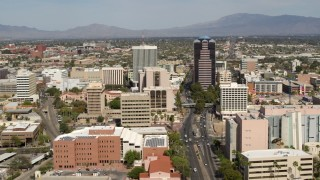 DX0002_144_027 - 5.7K stock footage aerial video of flying by tall high-rise office towers and city buildings in Downtown Tucson, Arizona