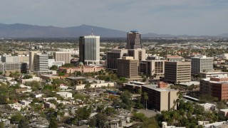 DX0002_144_031 - 5.7K stock footage aerial video of tall high-rise office towers and city buildings while ascending in Downtown Tucson, Arizona