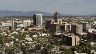 DX0002_144_032 - 5.7K stock footage aerial video of focusing on tall high-rise office towers and city buildings in Downtown Tucson, Arizona
