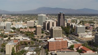 DX0002_144_033 - 5.7K stock footage aerial video focus on tall high-rise office towers surrounded by city buildings in Downtown Tucson, Arizona