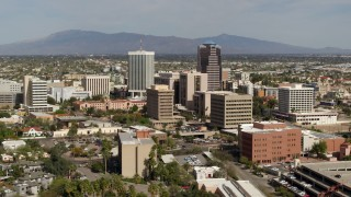 DX0002_144_036 - 5.7K stock footage aerial video approach tall office high-rises surrounded by city buildings in Downtown Tucson, Arizona
