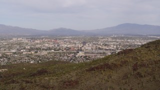 DX0002_145_011 - 5.7K stock footage aerial video the city of Tucson seen from Sentinel Peak, Arizona