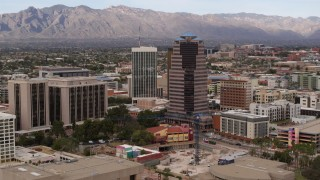 DX0002_145_016 - 5.7K stock footage aerial video orbit One South Church office high-rise, reveal Bank of America Plaza, Downtown Tucson, Arizona