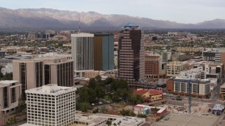 DX0002_145_017 - 5.7K stock footage aerial video orbit One South Church near office high-rises, Downtown Tucson, Arizona