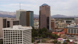 DX0002_145_020 - 5.7K stock footage aerial video descend and orbit the One South Church office high-rise, Downtown Tucson, Arizona